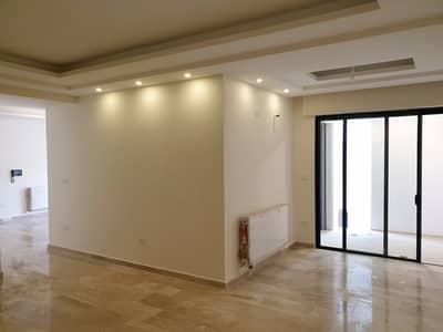 3 Bedroom Apartment for Sale in Tela Al Ali, Amman - شقه للبيع جديده لم تسكن طابق تسويه مطل في تلاع العلي