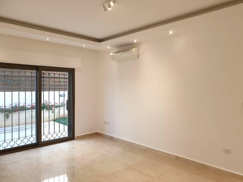 شقة ارضية مع حديقة و كراج خاص في عبدون