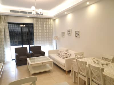 2 Bedroom Flat for Rent in Abdun, Amman - A luxurious, fully furnished Apartment for rent In Abdoun