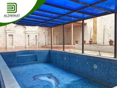 فیلا 10 غرف نوم للبيع في الجبيهة، عمان - فيلا شبه قصر للبيع في ارقى مناطق الجبيهة بمساحة بناء 1300 م