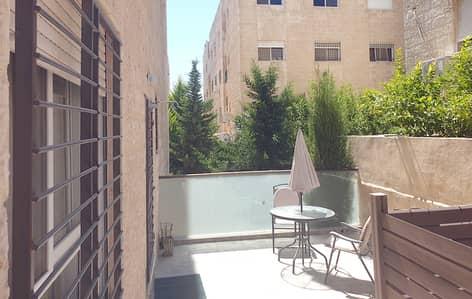 فلیٹ 3 غرف نوم للبيع في الجندويل، عمان - شقة ارضية للبيع في الجندويل مع ترس بسعر مميز