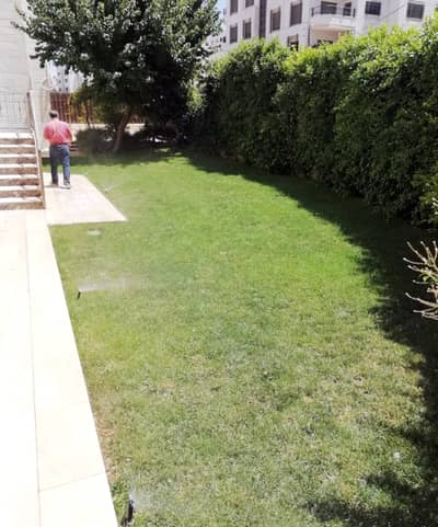 4 Bedroom Flat for Sale in Khalda, Amman - شقة أرضية مع حديقة كبيرة للبيع في خلدا
