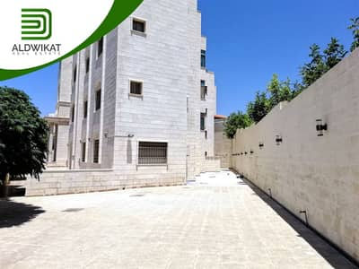 Residential Building for Sale in Marj Al Hamam, Amman - عمارة سكنية مميزة مكونة من 8 شقق وروف للبيع خلف كلية القدس