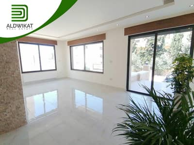 4 Bedroom Flat for Sale in Khalda, Amman - Ground floor apartment for sale in Khalda with building area 180 SQM with an external Terrasse