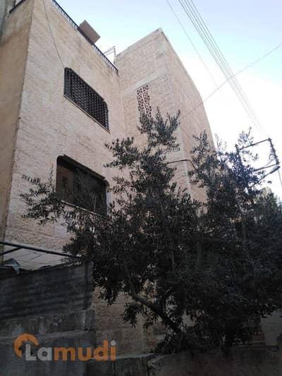 مجمع تجاري  للبيع في النصر، مادبا - Photo