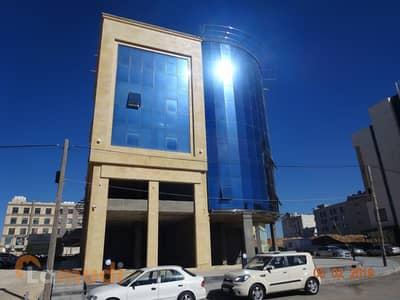 مجمع تجاري  للايجار في الدوار السابع، عمان - Photo