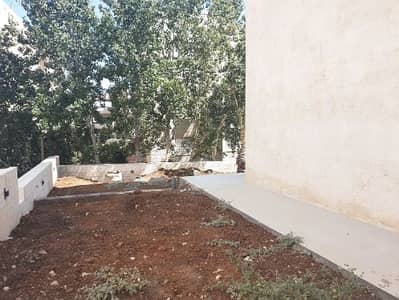 7 Bedroom Flat for Sale in 5th Circle, Amman - Duplex ground floor apartment for sale with garden, 5th Circle