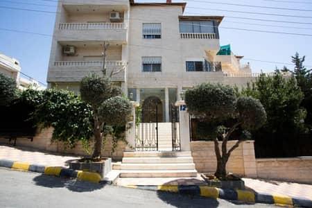 4 Bedroom Flat for Rent in Dair Ghbar, Amman - شقة أرضية معلقة للإيجار في دير غبار