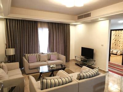فلیٹ 2 غرفة نوم للايجار في الشميساني، عمان - شقة أرضية مفروشة مغ حديقة للايجار في الشميساني | 100 م2