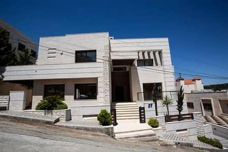 5 Bedroom Villa for Sale in Dabouq, Amman - فلل متلاصقة للبيع في موقع مميز في دابوق - IDUIDP14E