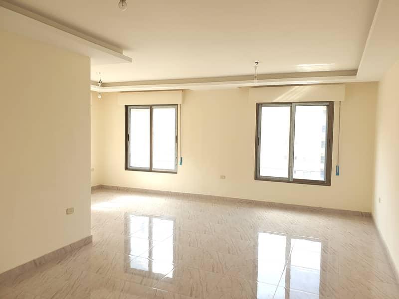 شقة جديدة للبيع في الرابية   180 م2
