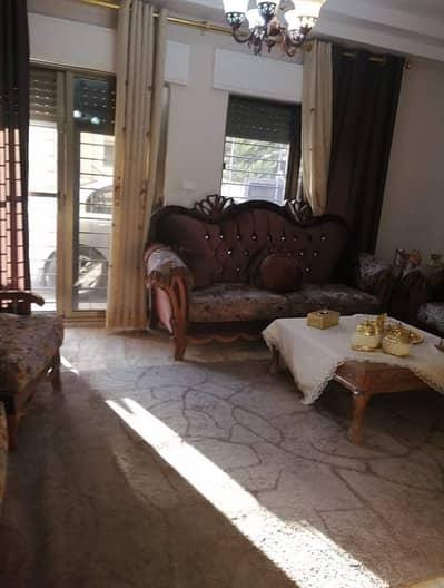 فلیٹ 3 غرف نوم للبيع في المدينة الرياضية، عمان - شقة ارضية للبيع في منطقة المدينة الرياضية 150 م2 مع 200 م2 خارجي