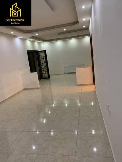 فلیٹ 3 غرف نوم للبيع في مرج الحمام، عمان - شقة أرضي معلق في مرج الحمام للبيع بمساحة 160م2 وترس 60م2