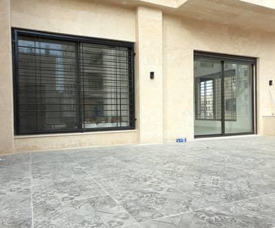 فلیٹ 4 غرف نوم للبيع في أم السماق، عمان - شقة أرضية مع ترس للبيع أم السماق | 230 م2