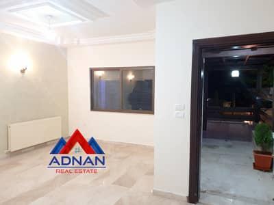 فلیٹ 3 غرف نوم للايجار في الرابية، عمان - شقة ارضية مع ترس وكراج خاص للإيجار في الرابية