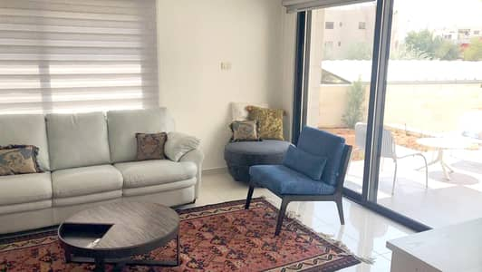 3 Bedroom Flat for Rent in Um Al Summaq, Amman - Ground floor furnished apartment with terrace in Um Al Summaq for rent