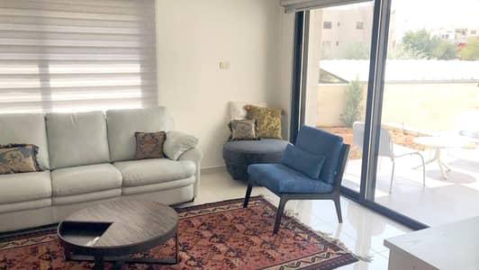 فلیٹ 3 غرف نوم للايجار في أم السماق، عمان - شقة أرضية مفروشة مع تراس في ام السماق للإيجار