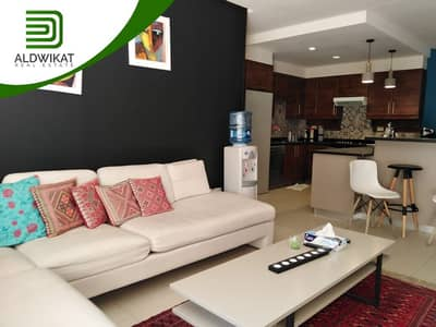 2 Bedroom Flat for Rent in 5th Circle, Amman - Luxurious flat suspended ground floor for rent in the 5th Circle