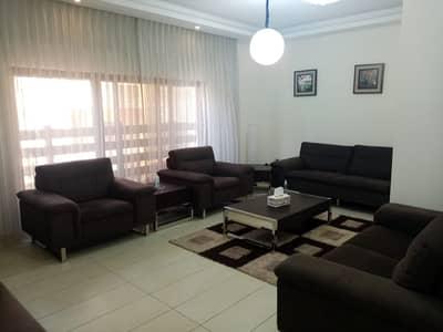 فلیٹ 2 غرفة نوم للايجار في عبدون، عمان - Furnished Mid floor Apartment for rent in Abdun