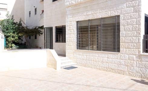 فلیٹ 3 غرف نوم للايجار في عبدون، عمان - عبدون شقة أرضية مع حديقة وكراج خاص للإيجار