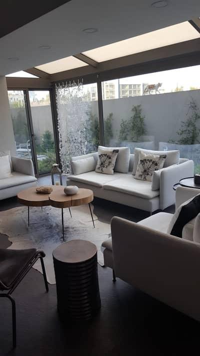 فلیٹ 2 غرفة نوم للايجار في الدوار الرابع، عمان - Garden Furnished Apartment for rent in 4th Circle  | 110 SQM