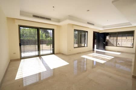 3 Bedroom Flat for Sale in Abdun, Amman - Abdun ground apartment with garden and private garage for sale
