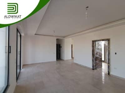 2 Bedroom Flat for Sale in Um Uthaynah, Amman - Semi-ground floor apartment for sale in Um Uthaynah
