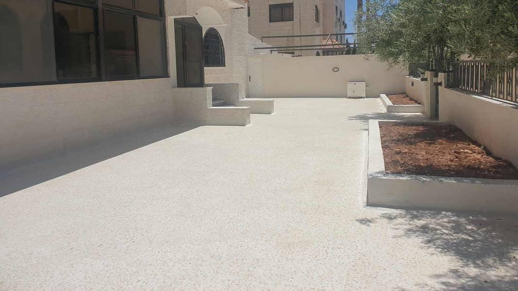 شقة أرضية مع ترس وحديقة  فارغة 180 متر في عبدون للإيجار السنوي