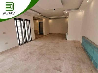 فلیٹ 4 غرف نوم للبيع في دابوق، عمان - شقة شبه ارضية على مستوى الشارع للبيع في دابوق  مساحة البناء 220 م2 مع حديقة و ترسات 120 م2
