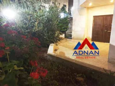 فلیٹ 3 غرف نوم للايجار في الرابية، عمان - شقة ارضية مفروشة مع حديقة للايجار في الرابية