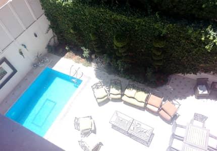 فیلا 5 غرف نوم للبيع في عبدون، عمان - فيلا متلاصقة للبيع مع مسبح في أرقى مناطق عبدون