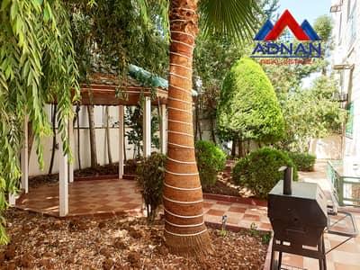 فلیٹ 3 غرف نوم للايجار في الرابية، عمان - شقة مفروشة أرضية مع حديقة كبيرة للإيجار في الرابية