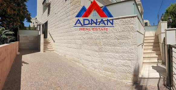 3 Bedroom Flat for Sale in Abdun, Amman - Ground Floor Apartment with Garden and Private Parking For Sale In Abdun