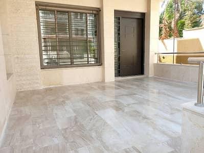 4 Bedroom Flat for Sale in Mecca Street, Amman - شقة ارضية مع ترس جديدة 4 نوم للبيع شارع مكه